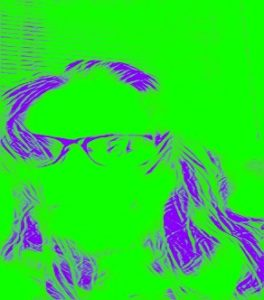Stylized filtered photograph of the author wearing glasses sitting in front of blinds with a mostly bright green background, with parts of their hair and glasses outlined in purple grape lines. In the left lens of their glasses is a reflection of the author's cell phone used to take this selfie.